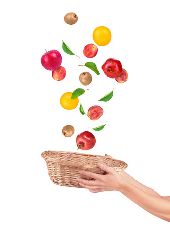 alling: Fruit alling from basket isolated on a white