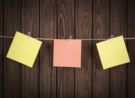 tack board: note papers on wooden board Stock Photo
