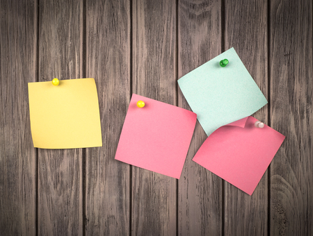 tack board: note papers on wooden background Stock Photo