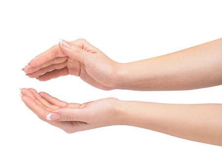 manos abiertas: Dos manos que protegen algo aislado en blanco.