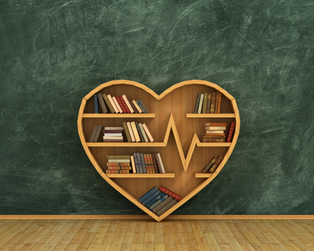 Concept of training. Wooden bookshelf full of books in form of heart on the blackboard background. Science about human. Medicine. A human have more knowledge about health.