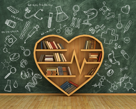 Wooden bookshelf full of books in form of heart on the blackboard background with medicine drawings Stock Photo