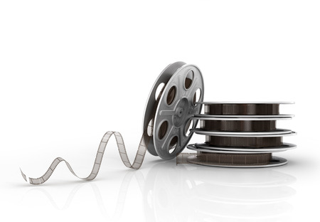 film: Stack of film reels on a white background.