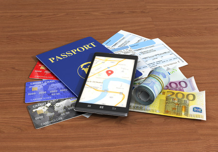 ides: Business travel and tourism concept; air tickets, passport, smartphone and credit cards