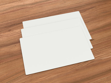 not full: 3 white business cards on a wooden blocked.