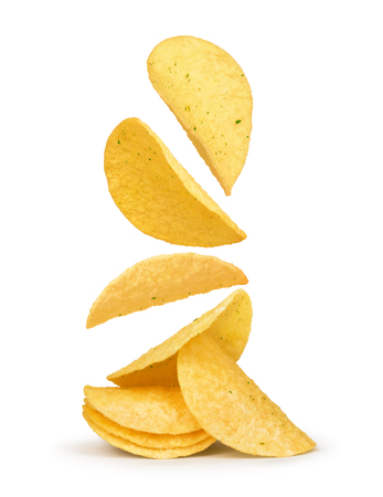potato chips falling in the air on an isolated white background Stock Photo