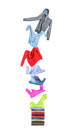 casual clothing: Clothing flies on a pile isolated on white background