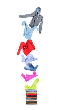casual clothes: Ropa vuela en una pila aislada sobre fondo blanco