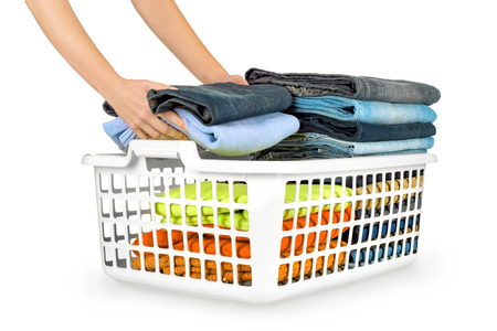 folded clothes: Laundry basket with folded clothes over white background Stock Photo