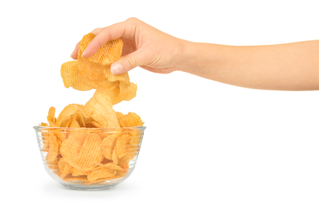 potato chips: Hand with potato chips and bowl on white background Stock Photo