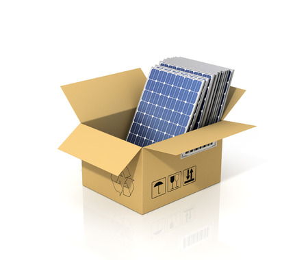 enviroment: Concept of alternative energy. Stack of solar battery panels in the cardboard box. Enviroment protection.