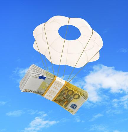 money flying: money flying on a parachute Stock Photo