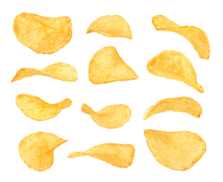 Set of potato chips close-up on an isolated white background Foto de archivo
