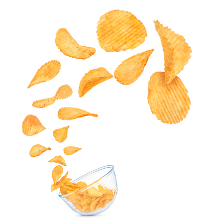 potato chips in the air fall in a bowl isolated on white background