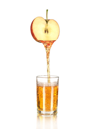 apple Juice pouring into glass isolated on white Stock Photo