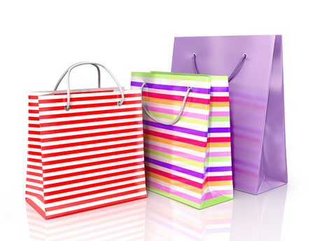 solvency: Colorful paper bags for shopping on a white background. Stock Photo