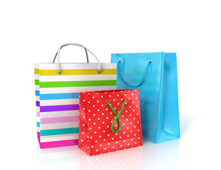 solvency: Three colorful paper bags for shopping on a white background. Stock Photo
