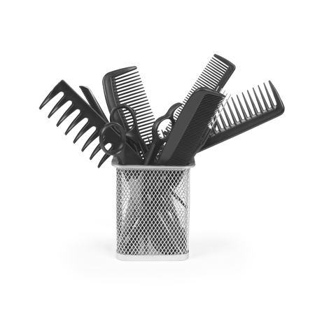 salon background: Iron basket with round hair brushes, isolated on white Stock Photo