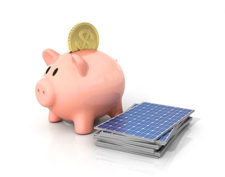 solar industry: Concept of saving money if using solar energy. Solar panels near moneybox in the form of pig.