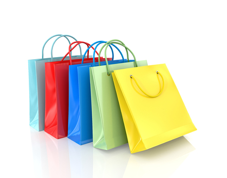 delinquent: Three colorful paper bags for shopping on a white background. Stock Photo