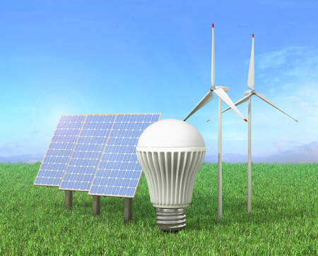 led light bulb: Concept of green energy. Wind tower, LED light bulb and solar energy panel in a grass.