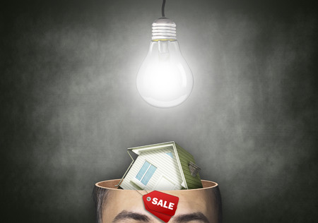 home sale: House cut in his head, thought the concept of sales Stock Photo