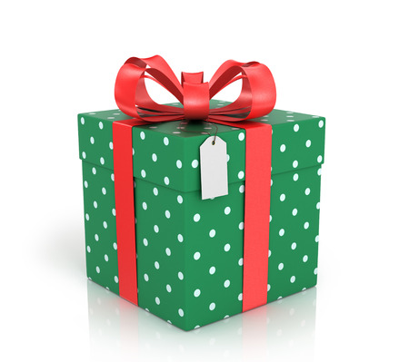 christmas carols: Gift box wrapped with red ribbon with a red bow on a white background. Stock Photo