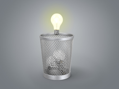 discard: glowing light bulb under the bin with other lamps
