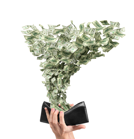 whirlwind: a whirlwind of dollars comes out of an open wallet Stock Photo