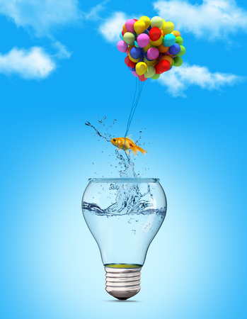 success symbol: Gold fish flying away from a lightbulb with the help of a balloons