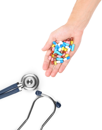 aide: a doctors stethoscope and pills isolated on white Stock Photo