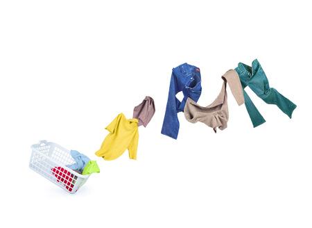 casual clothes: Ropa cae en una cesta de lavander�a Foto de archivo
