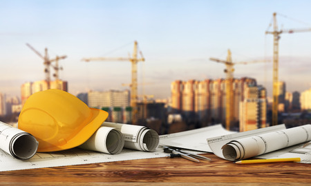 site manager: 3d render of blueprints and designer tools on the panorama of construction site. Stock Photo