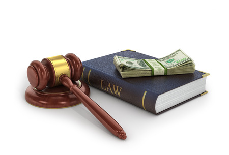 bribes: Concept of bribes. The wooden gavel with book of law and money on a white background. Stock Photo