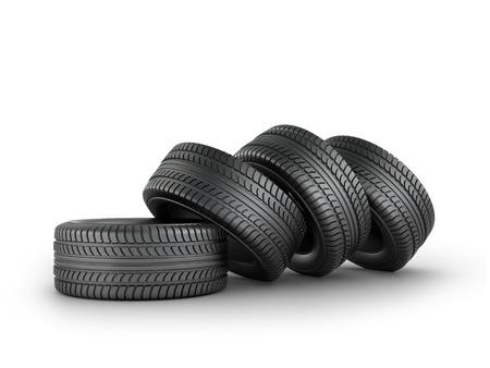 Cuatro neumáticos de caucho negro sobre un fondo blanco.