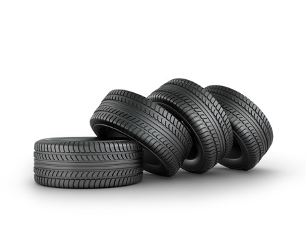 automobile tire: Four black rubber tires on a white background.