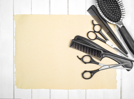 black barber: Professional hairdresser tools on table close-up