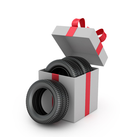 car tire: Gift box inside which tires on a white background.
