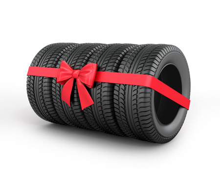 A set of rubber tires with ribbon and bow.