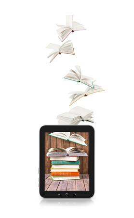 libros volando: Los libros de vuelo en una tableta aislado en blanco