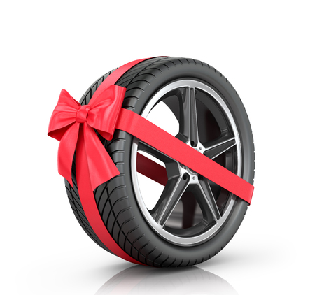 multiplicity: Car wheel wrap a red ribbon with a bow on a white background. Stock Photo