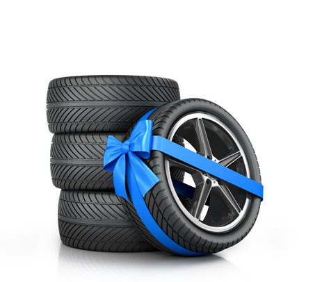 enveloped: Car Wheel enveloped in a blue ribbon and bow on a white background.