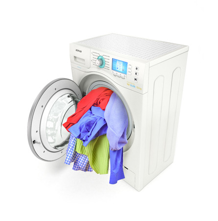 household tasks: A close up of a washing machine loaded with clothes isolated on white background