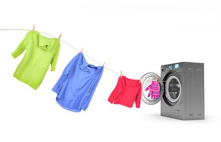 white wash: clothes on a rope with a washing machine Stock Photo