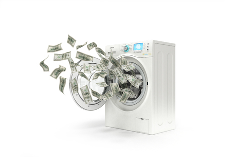 money laundering concept, dollar bills fly in the washing machine Archivio Fotografico