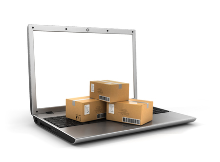 Shipping, delivery and logistics technology business industrial concept. Heap of stacked corrugated cardboard package boxes on computer PC laptop. Delivery concept. Standard-Bild