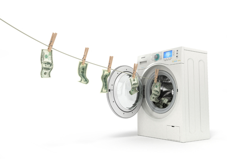 launder: concept of money laundering, money hanging on a rope coming out of the washing machine Stock Photo