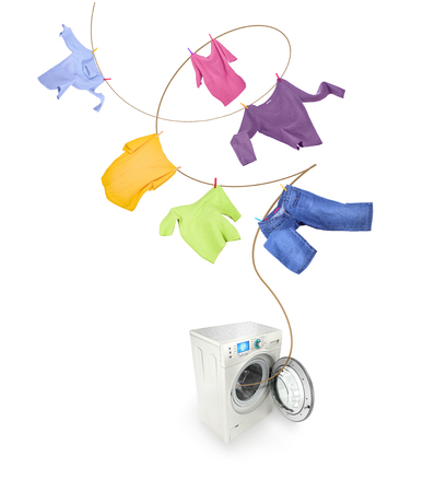 Clothes hanging and washing machine isolated on white background