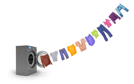 soggy: clothespins on a rope coming out of the dark washing machine Stock Photo