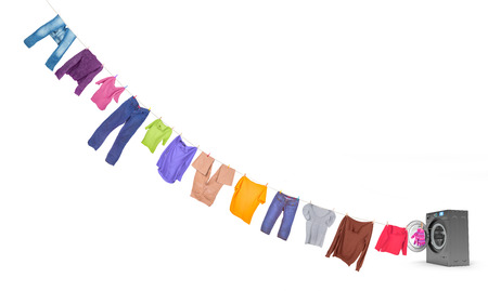 launder: clothespins on a rope coming out of the dark washing machine Stock Photo